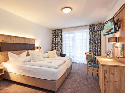 Schlafzimmer in den Suiten